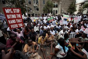 Kenyans protesting against parliamentary corruption
